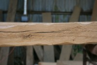 an air-dried oak beam with scalloped edges